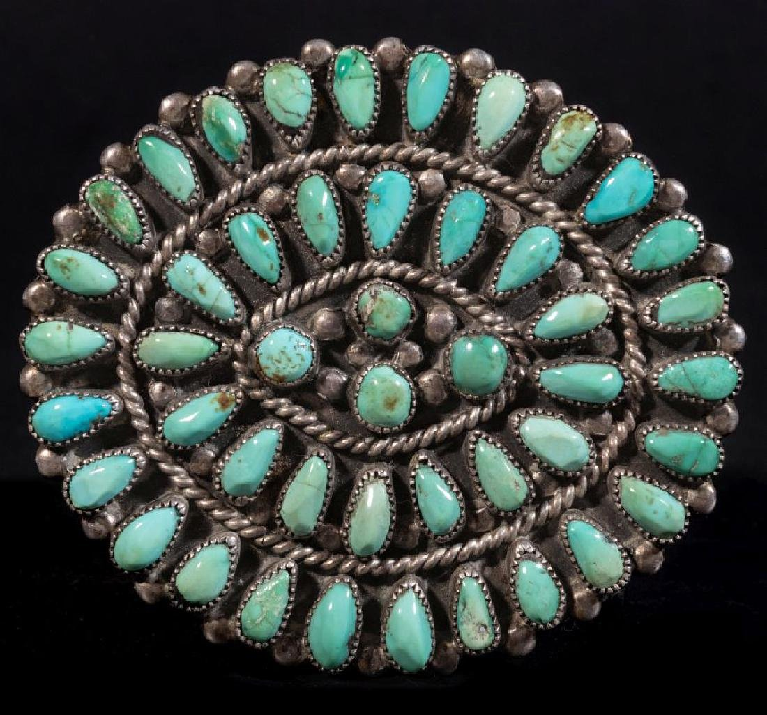 A ZUNI PETTIPOINT STERLING AND TURQUOISE BROOCH