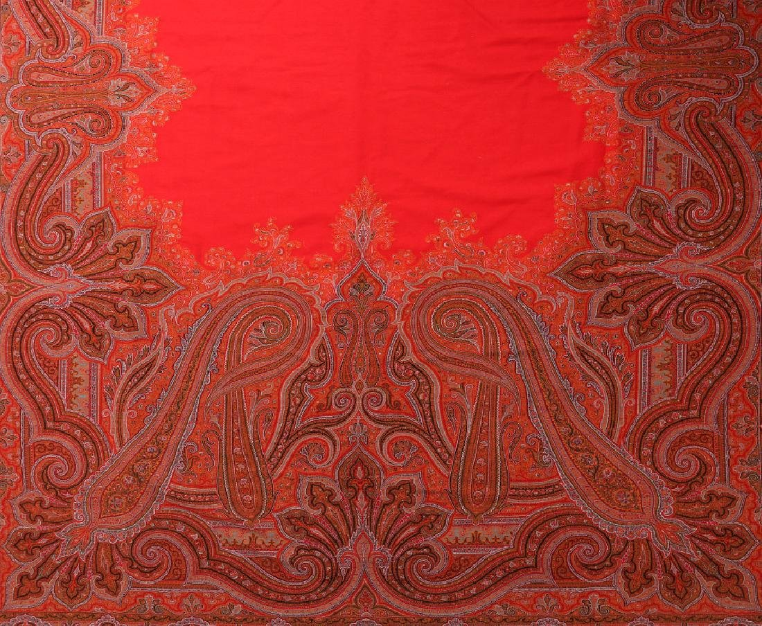 A LARGE FINE RED PAISLEY PIANO SCARF OR SHAWL