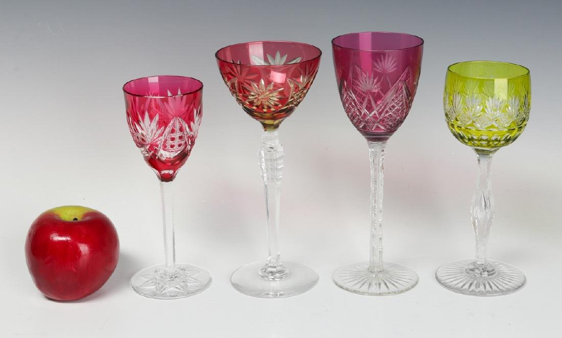 A COLLECTION OF COLORED CUT TO CLEAR CRYSTAL WINES - 10