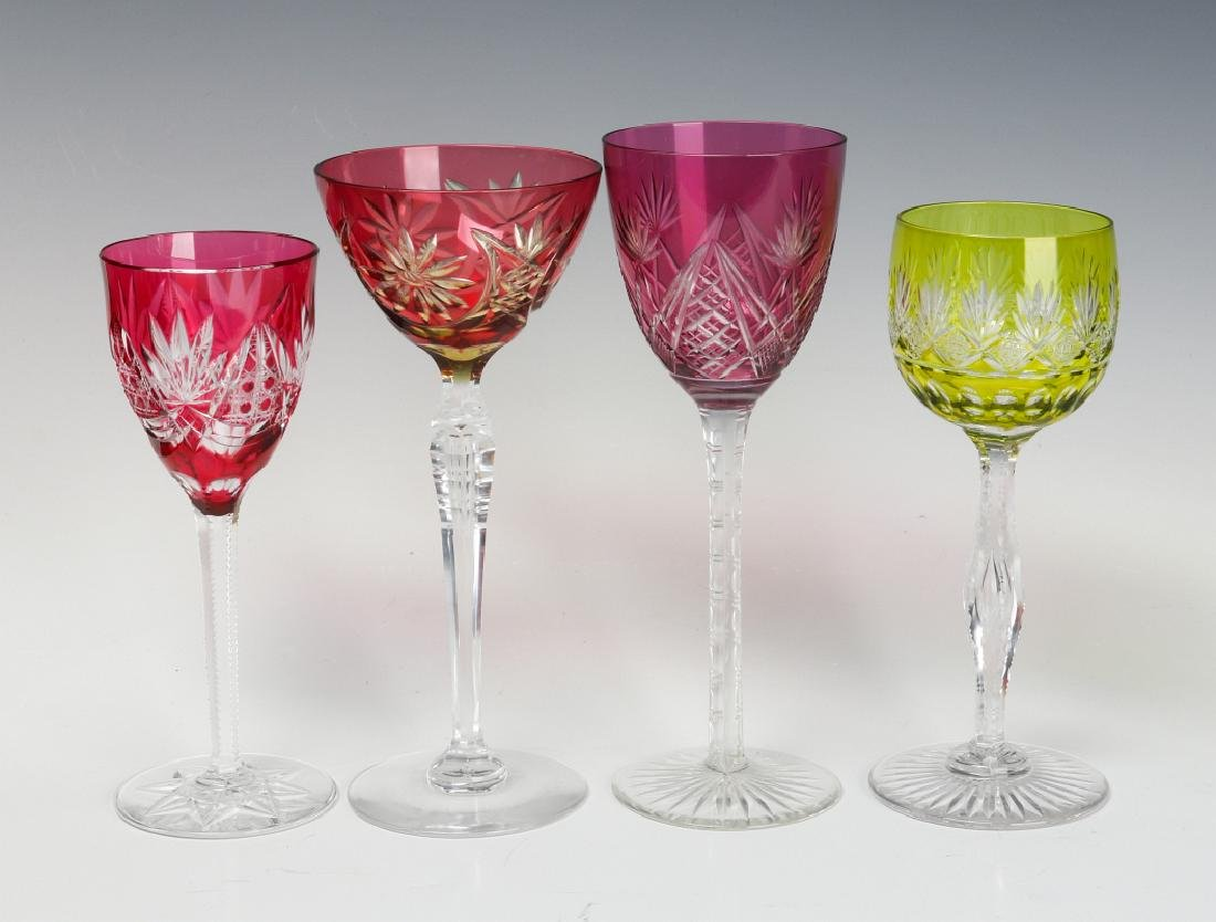 A COLLECTION OF COLORED CUT TO CLEAR CRYSTAL WINES