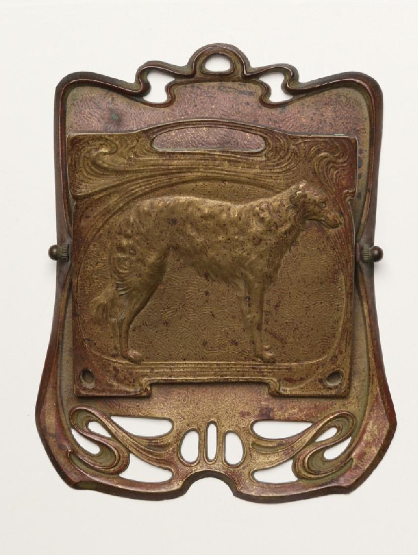 AN ART NOUVEAU INFLUENCE BILL CLIP WITH DOG C 1900