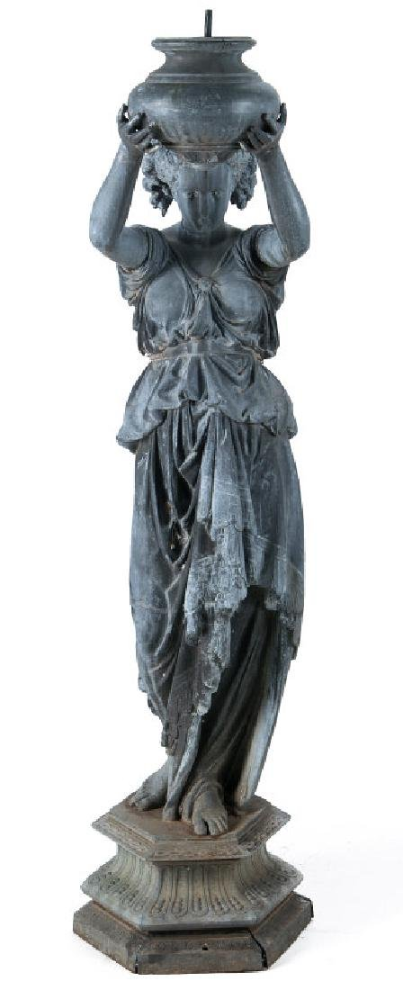 A LIFE-SIZED 19TH C ZINC CLASSICAL MAIDEN WITH URN