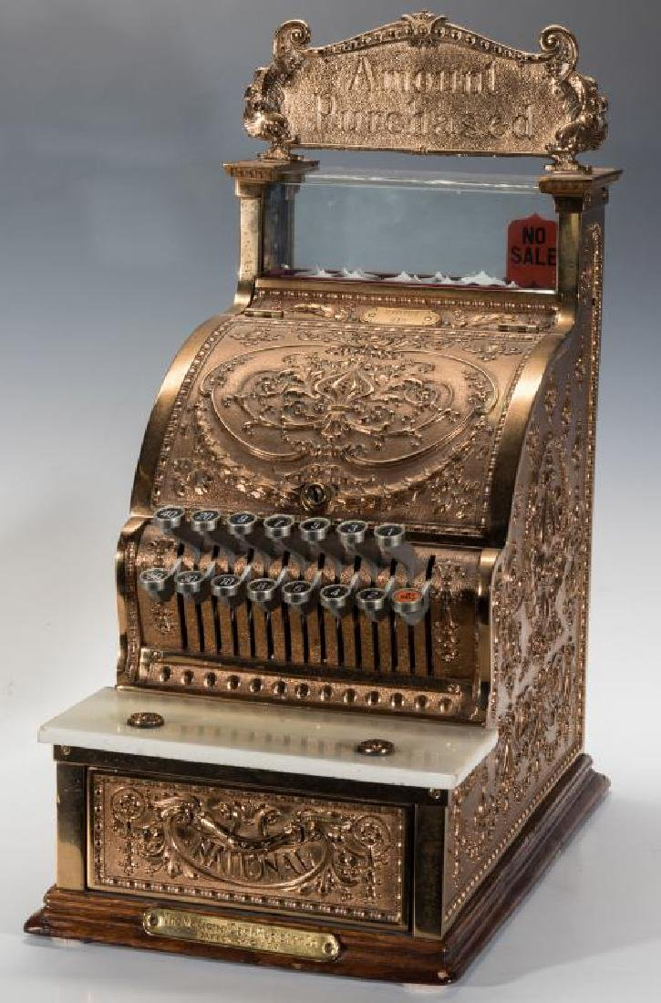 A MODEL 312 NATIONAL CASH REGISTER WITH TOP SIGN