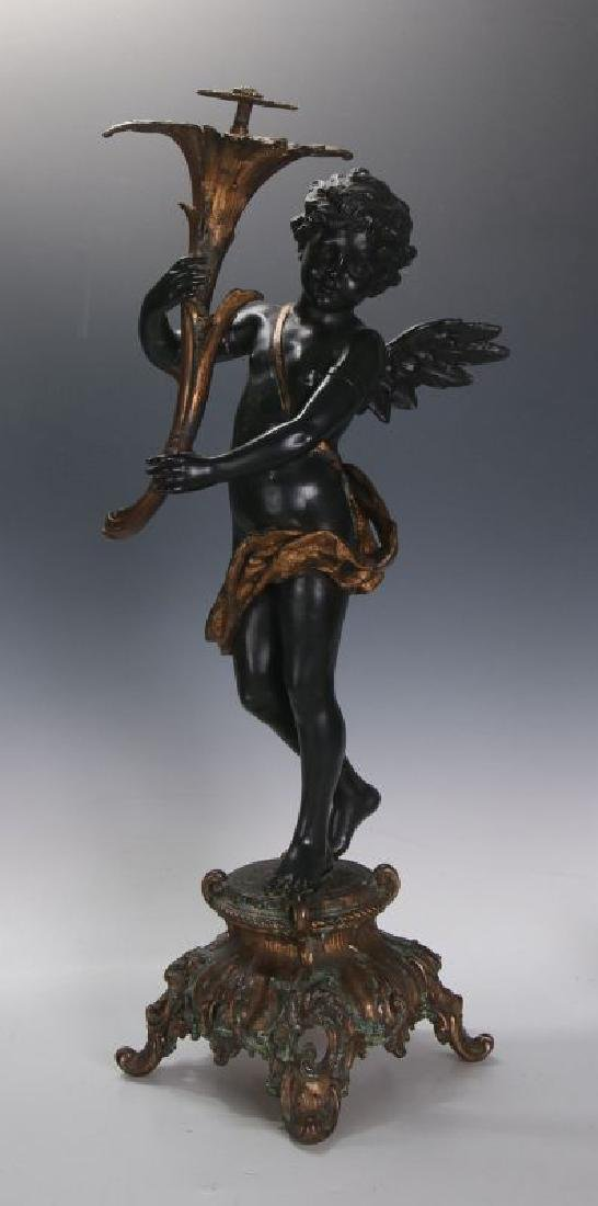 AN ANTIQUE 24-INCH PATINATED SPELTER CUPID FIGURE