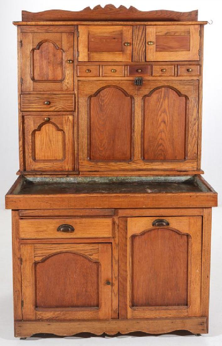 AN UNUSUAL MULTI-DRAWER KITCHEN CABINET