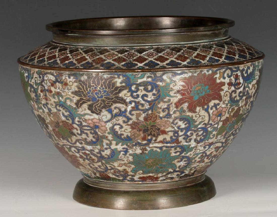 A CHINESE BRONZE JARDINIERE WITH CHAMPLEVE' ENAMEL