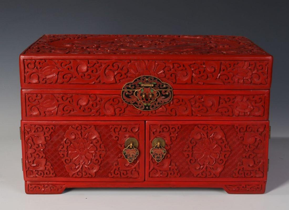 A LARGE CINNABAR JEWELRY CASKET WITH CLOISONNE