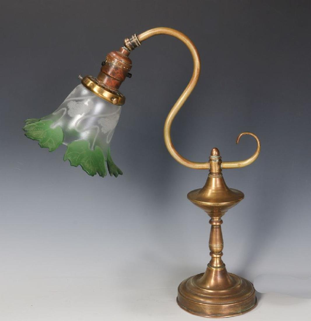 A BRASS LAMP WITH UNUSUAL CUT BACK SHADE C. 1900