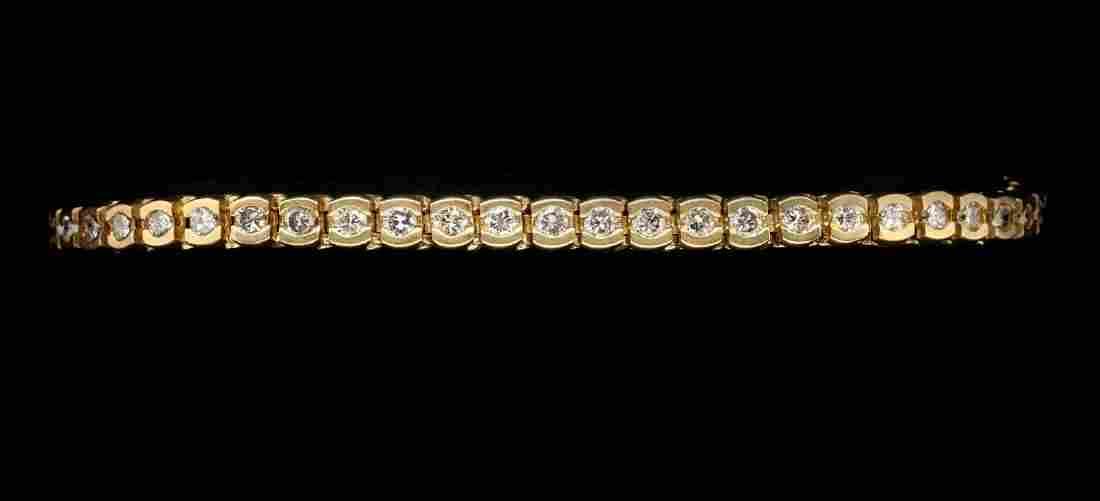 A 14K GOLD AND DIAMOND TENNIS BRACELET 3 CT T.W.