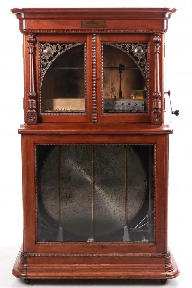 A REGINA COIN OPERATED 27-INCH DISC MUSIC BOX