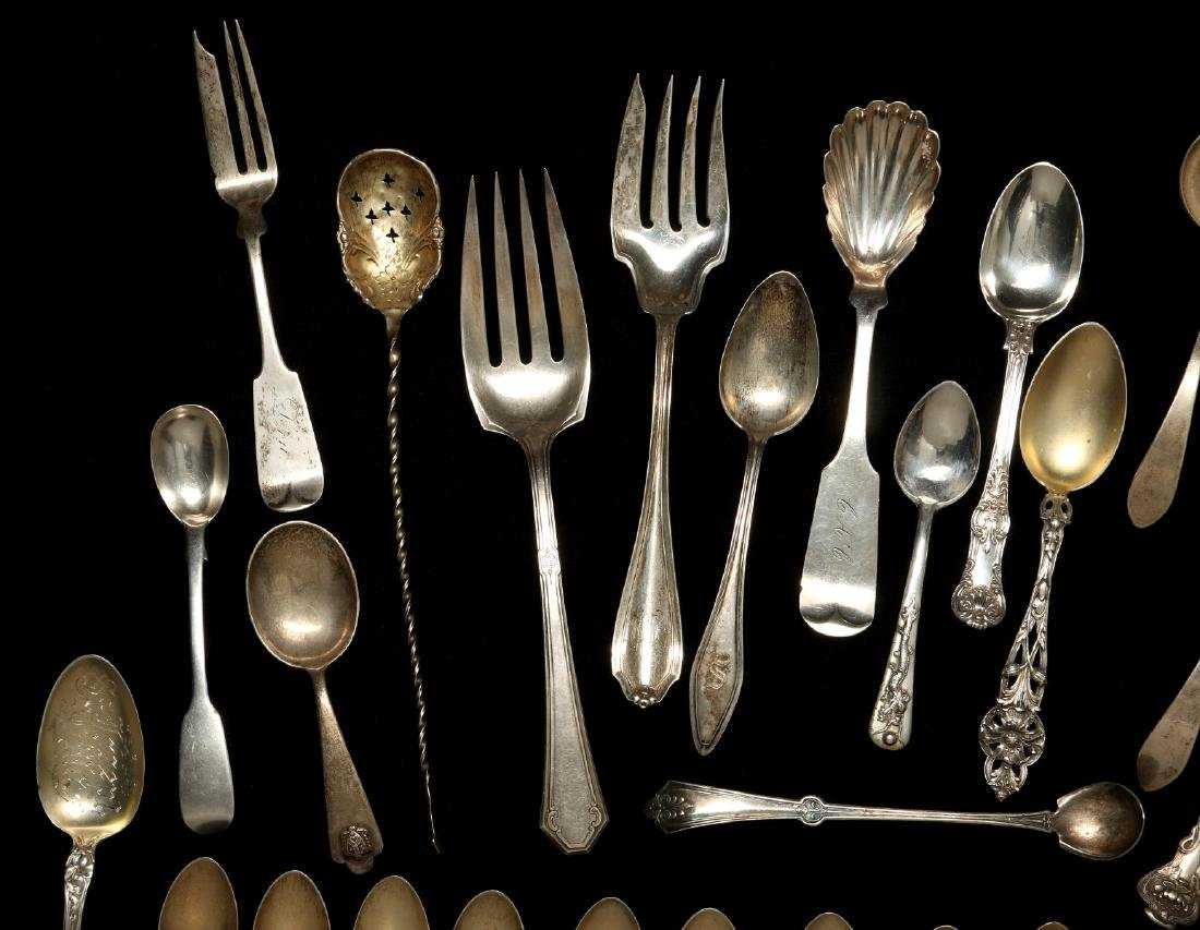 A COLLECTION OF STERLING SILVER FLATWARE - 2