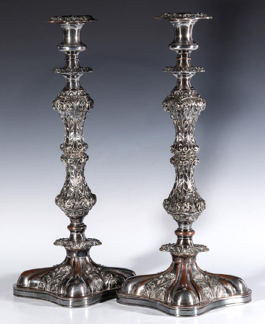 A PAIR ENGLISH SILVER PLATED ROCOCO CANDLESTICKS