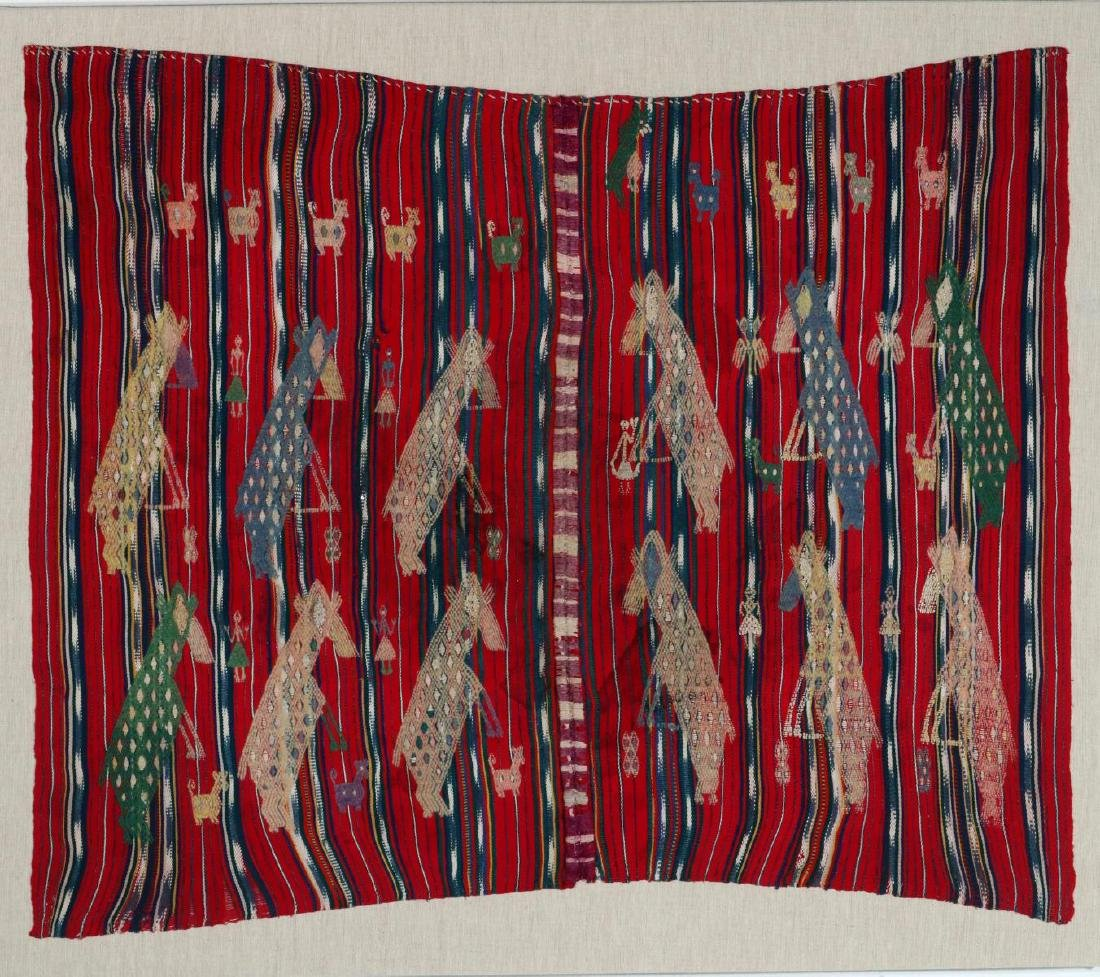 A VINTAGE LOOMED TEXTILE WITH EMBROIDERED FIGURES
