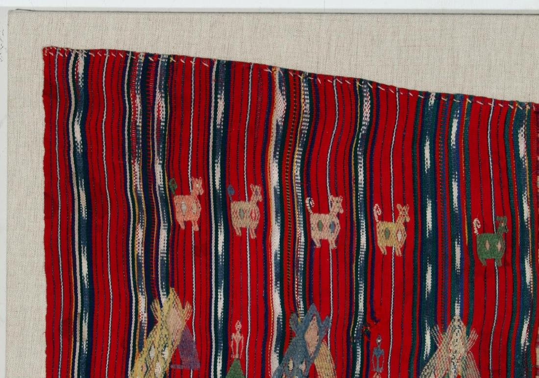 A VINTAGE LOOMED TEXTILE WITH EMBROIDERED FIGURES - 2