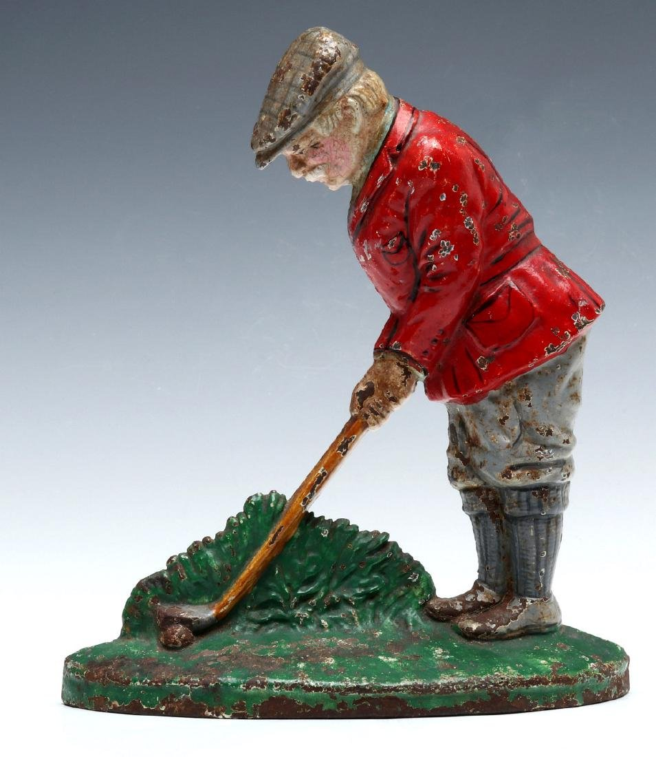 A HUBLEY PUTTING GOLFER CAST IRON DOORSTOP #34