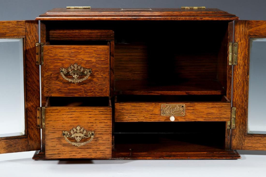 A CIRCA 1920s OAK PLAYING CARD AND GAMES CABINET - 2