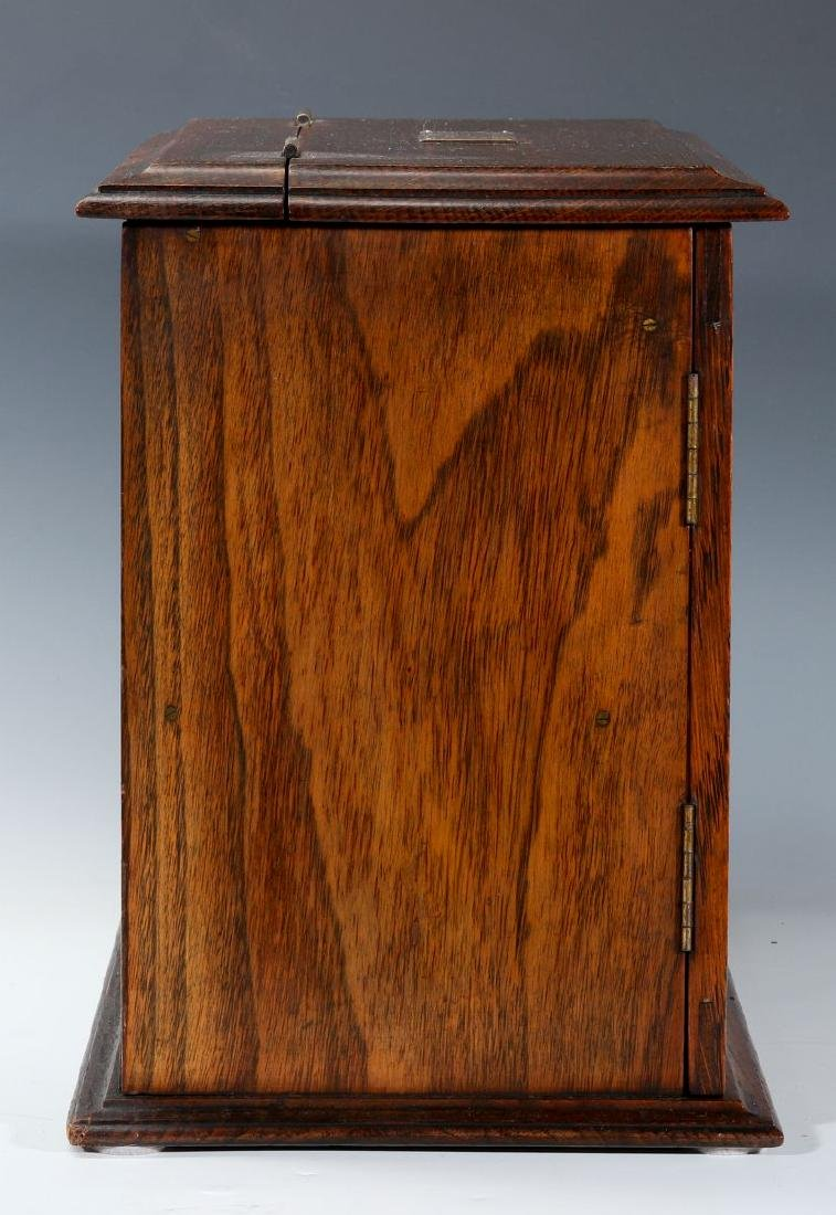 A CIRCA 1920s OAK PLAYING CARD AND GAMES CABINET - 3