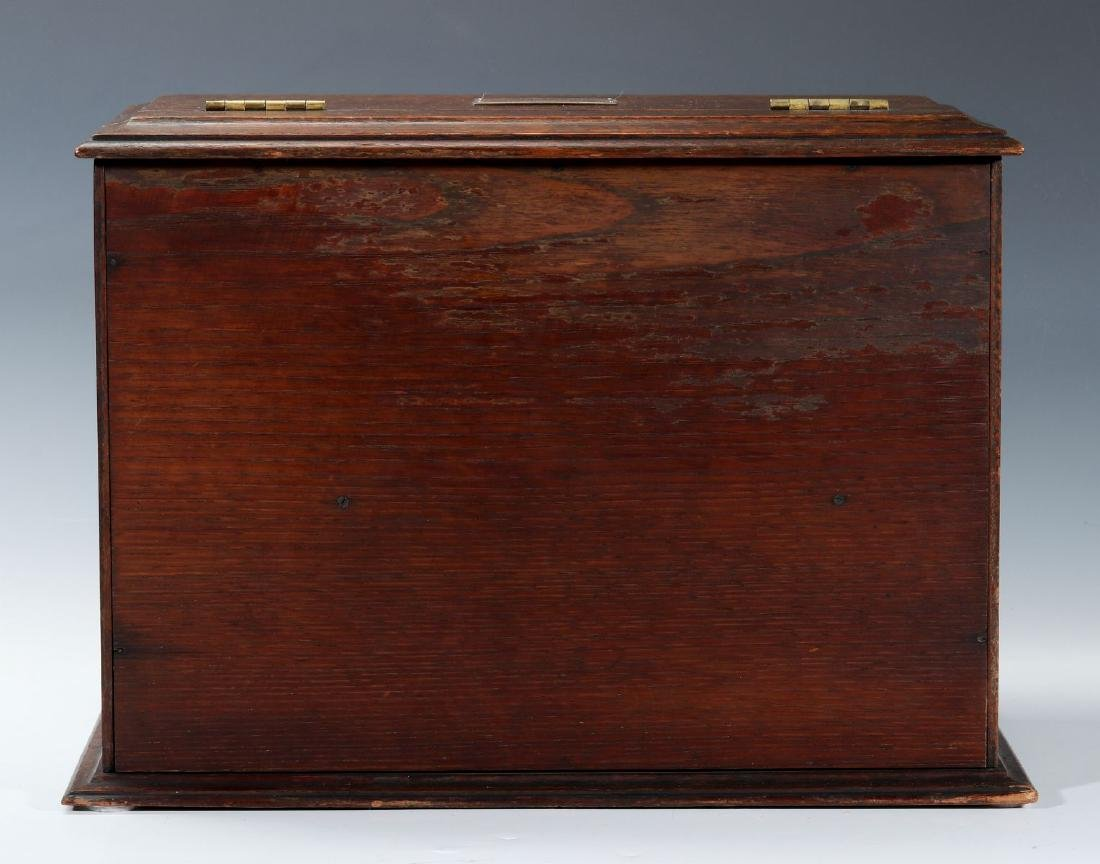A CIRCA 1920s OAK PLAYING CARD AND GAMES CABINET - 4