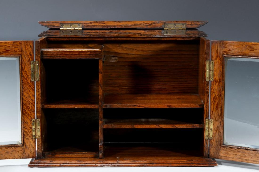 A CIRCA 1920s OAK PLAYING CARD AND GAMES CABINET - 8
