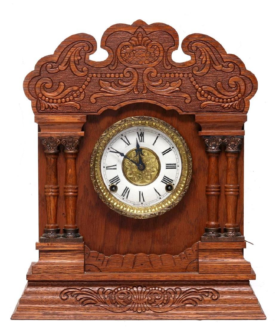 A NEW HAVEN CLOCK CO. GINGERBREAD MANTLE CLOCK