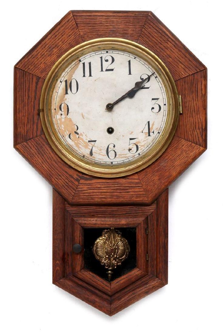 A WATERBURY SHORT DROP SCHOOLHOUSE CLOCK