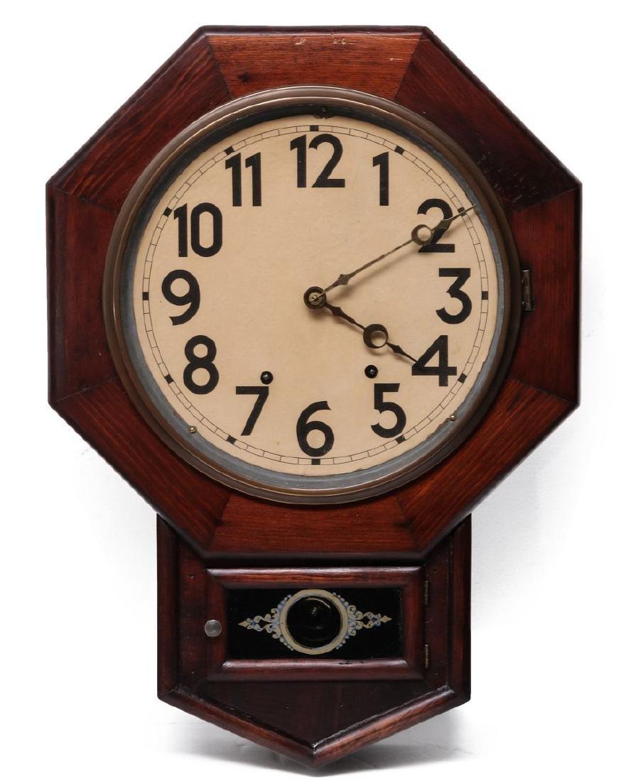 A SETH THOMAS SCHOOLHOUSE CLOCK