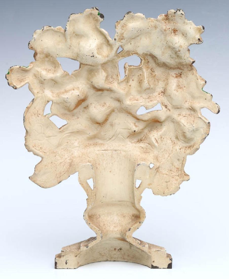 A HUBLEY GLADIOLUS CAST IRON DOORSTOP NO. 489 - 7