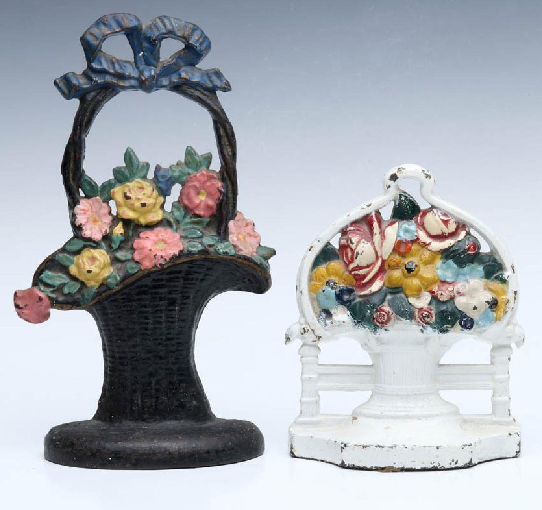 TWO CAST IRON FLOWER BASKET DOORSTOPS