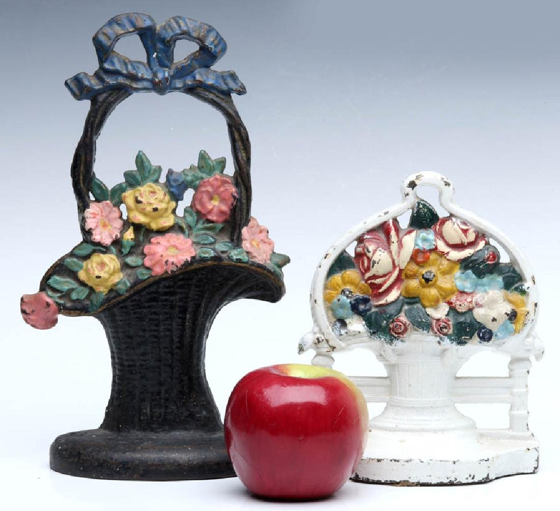 TWO CAST IRON FLOWER BASKET DOORSTOPS - 2