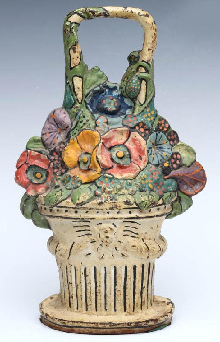 A CAST IRON FLOWER BASKET DOORSTOP