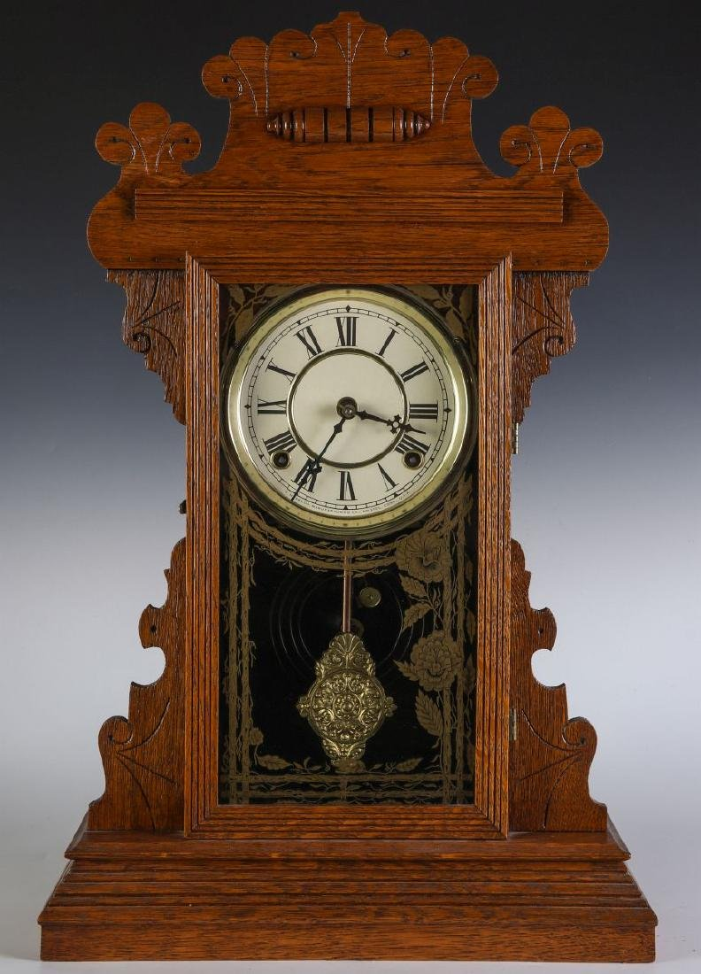 A KITCHEN GINGERBREAD CLOCK ATTRIBUTED E.N. WELCH