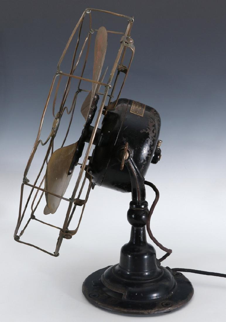 AN EMERSON ELECTRIC TABLE FAN WITH YOKE CIRCA 1912 - 10