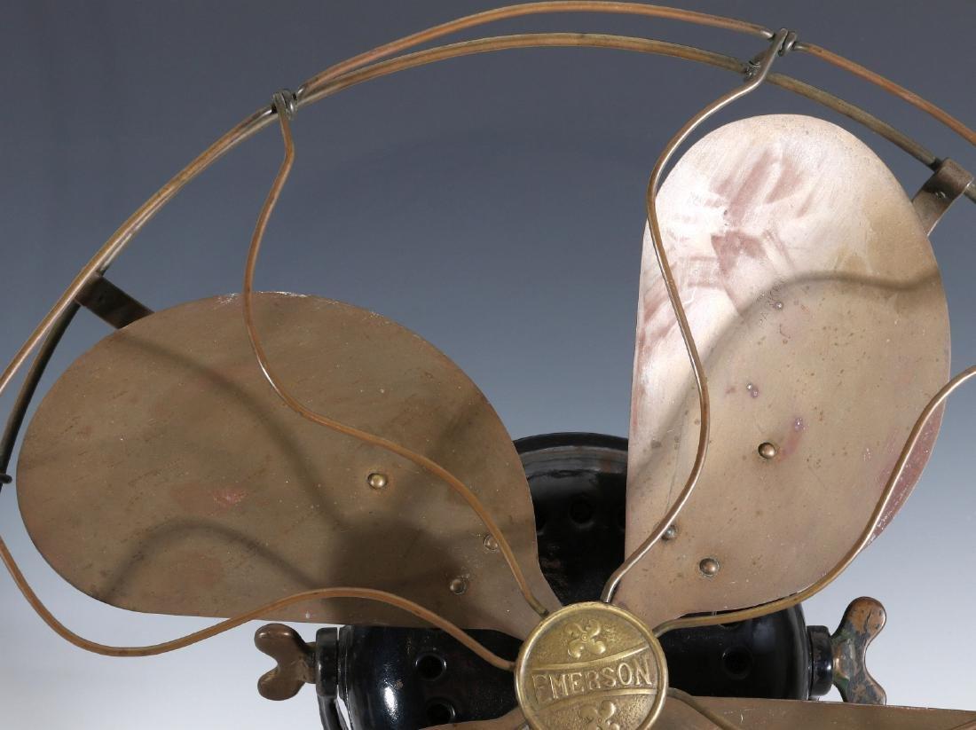 AN EMERSON ELECTRIC TABLE FAN WITH YOKE CIRCA 1912 - 2