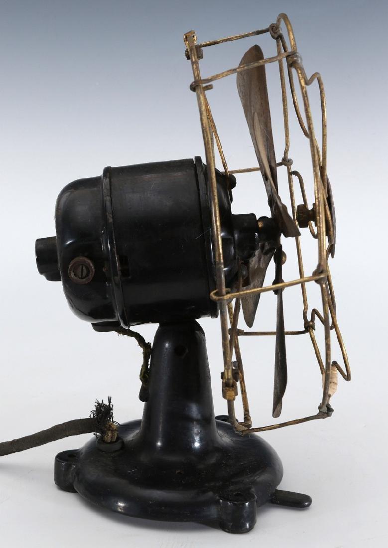A PEERLESS TAB-FOOT ELECTRIC FAN CIRCA 1909 - 10