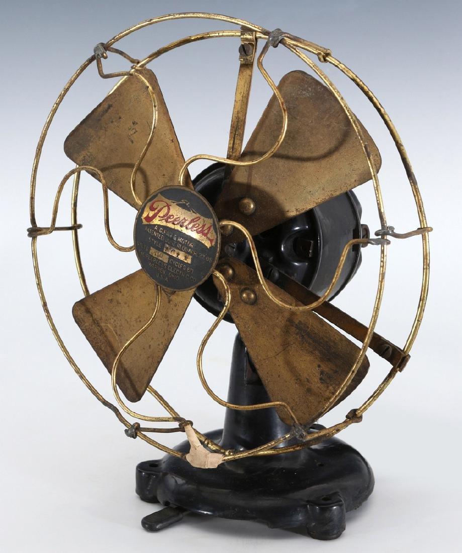 A PEERLESS TAB-FOOT ELECTRIC FAN CIRCA 1909