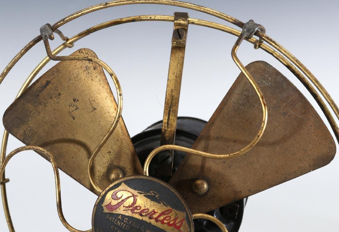A PEERLESS TAB-FOOT ELECTRIC FAN CIRCA 1909 - 2
