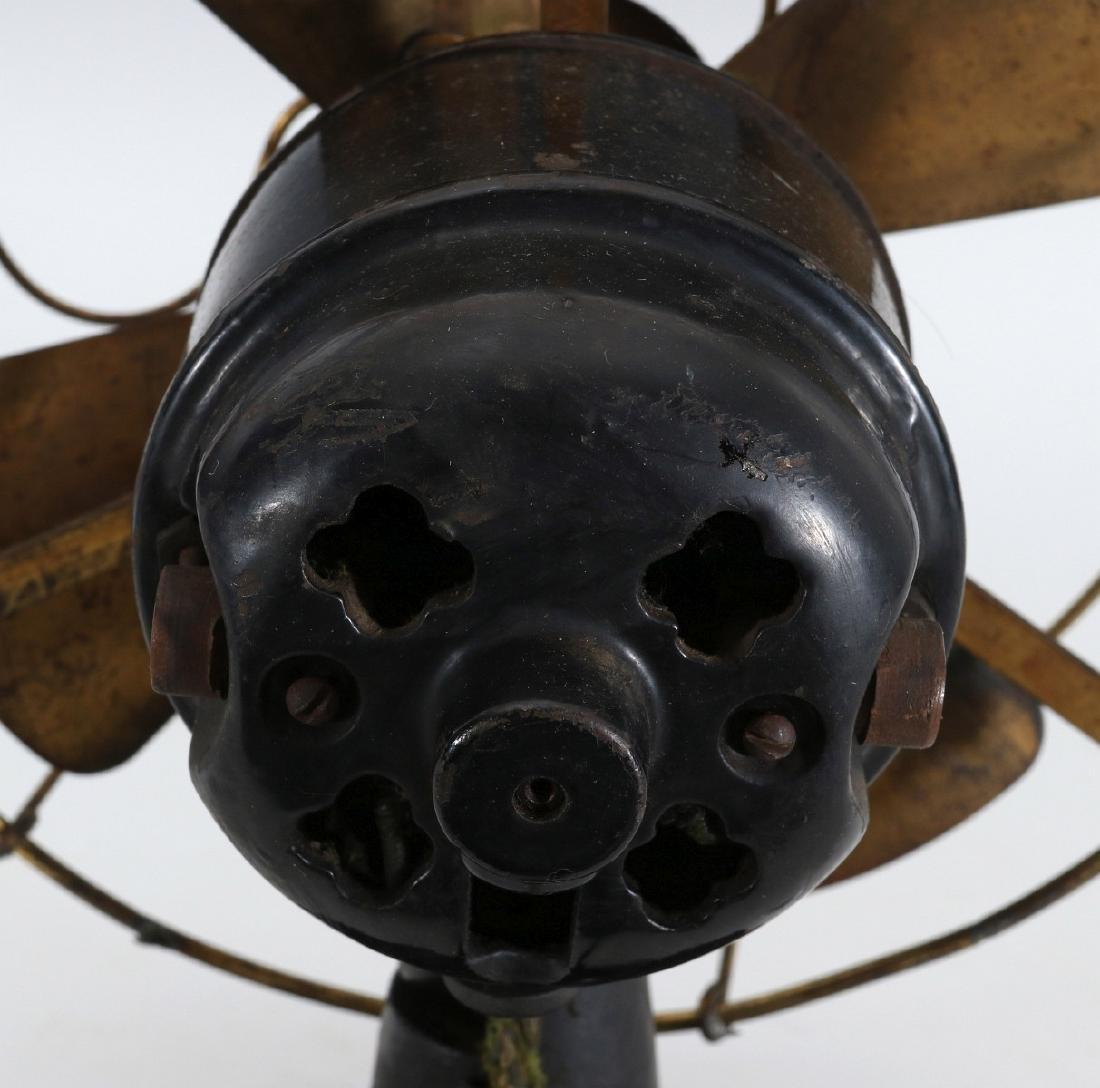 A PEERLESS TAB-FOOT ELECTRIC FAN CIRCA 1909 - 9