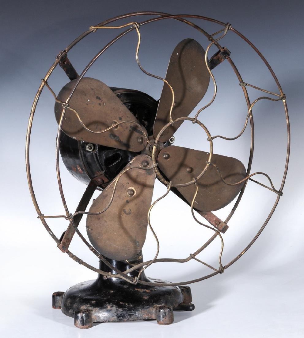 A COLONIAL BRAND TAB FOOT ELECTRIC FAN CIRCA 1910