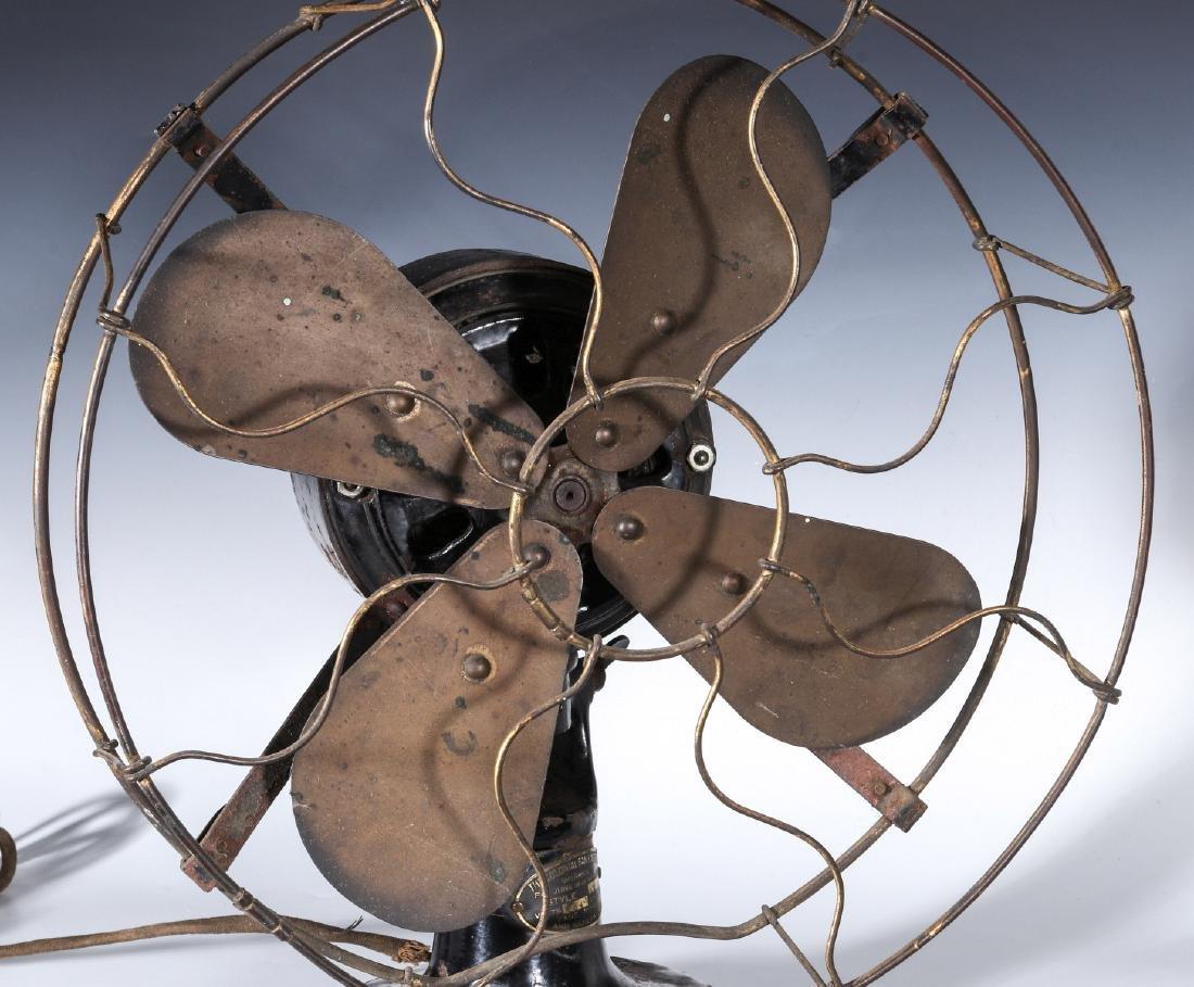 A COLONIAL BRAND TAB FOOT ELECTRIC FAN CIRCA 1910 - 2