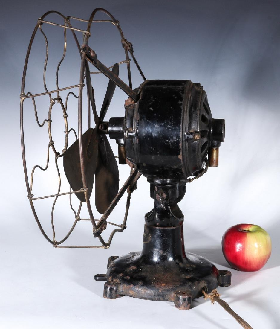 A COLONIAL BRAND TAB FOOT ELECTRIC FAN CIRCA 1910 - 7