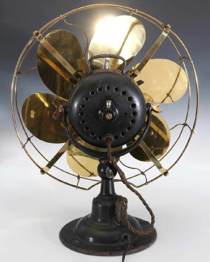 AN EMERSON ELECTRIC TABLE FAN WITH YOKE CIRCA 1914 - 8