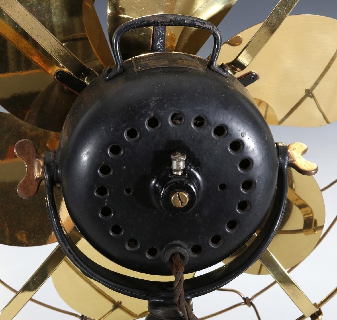 AN EMERSON ELECTRIC TABLE FAN WITH YOKE CIRCA 1914 - 9