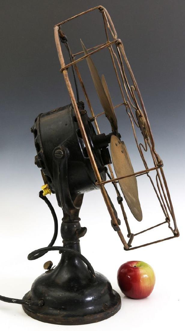 A GENERAL ELECTRIC YOKE MOUNT FAN, CIRCA 1901 - 5