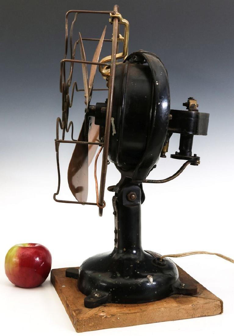 A MENOMINEE TAB-FOOT FAN, CIRCA 1912 - 5