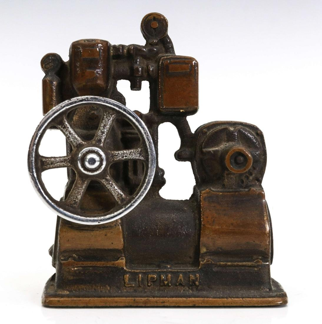 A LIPMAN FIGURAL ENGINE ADVERTISING PAPERWEIGHT