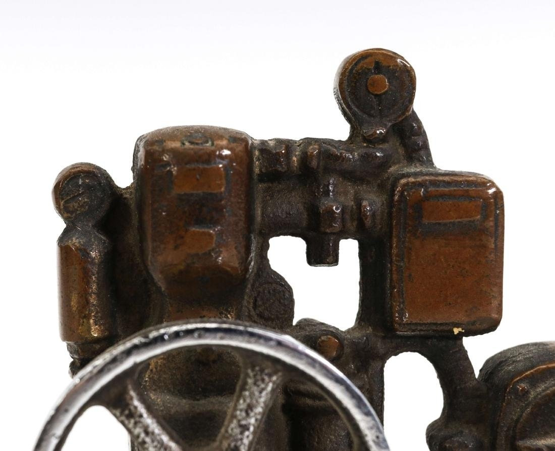 A LIPMAN FIGURAL ENGINE ADVERTISING PAPERWEIGHT - 2