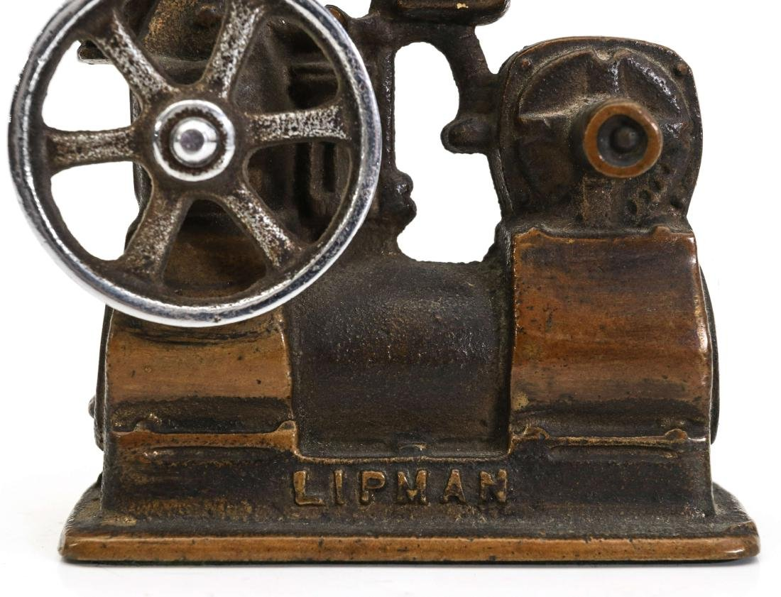 A LIPMAN FIGURAL ENGINE ADVERTISING PAPERWEIGHT - 4
