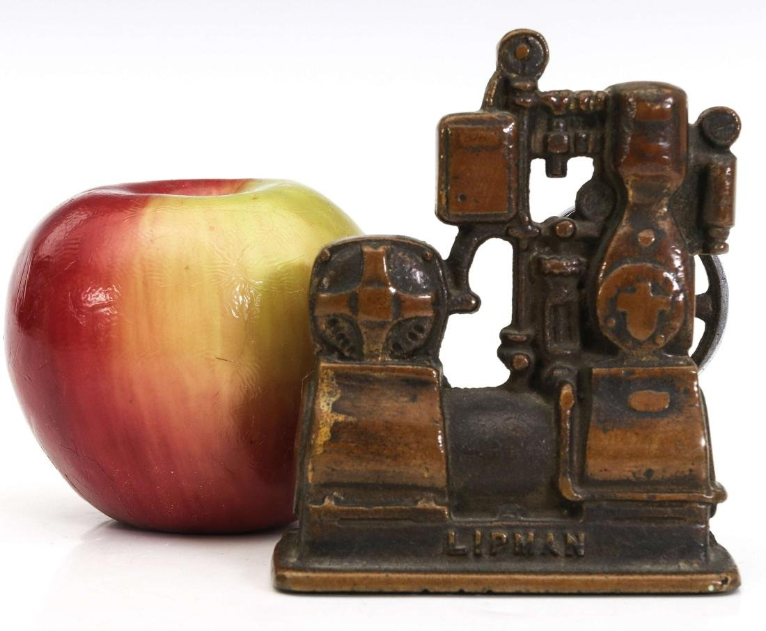 A LIPMAN FIGURAL ENGINE ADVERTISING PAPERWEIGHT - 6