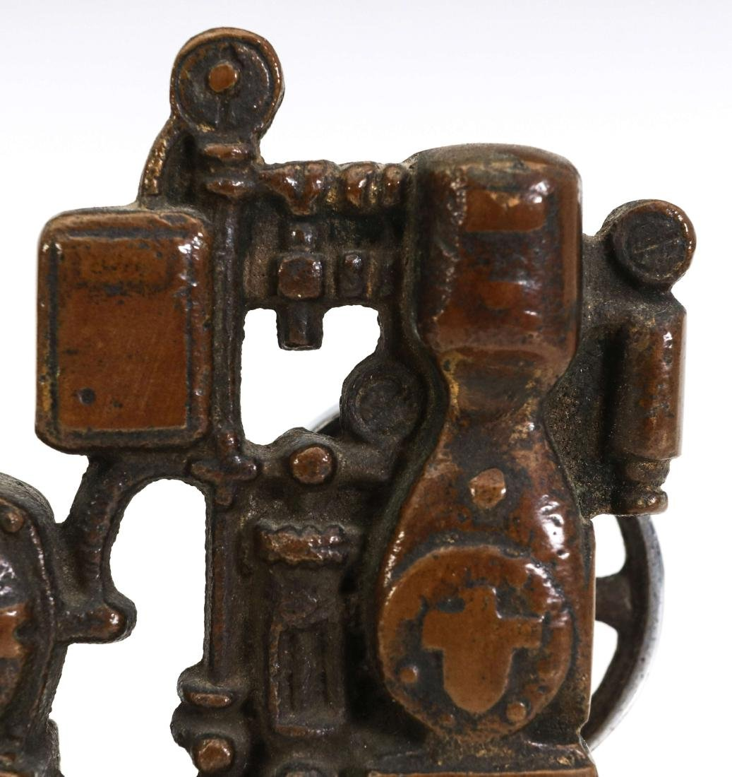 A LIPMAN FIGURAL ENGINE ADVERTISING PAPERWEIGHT - 7