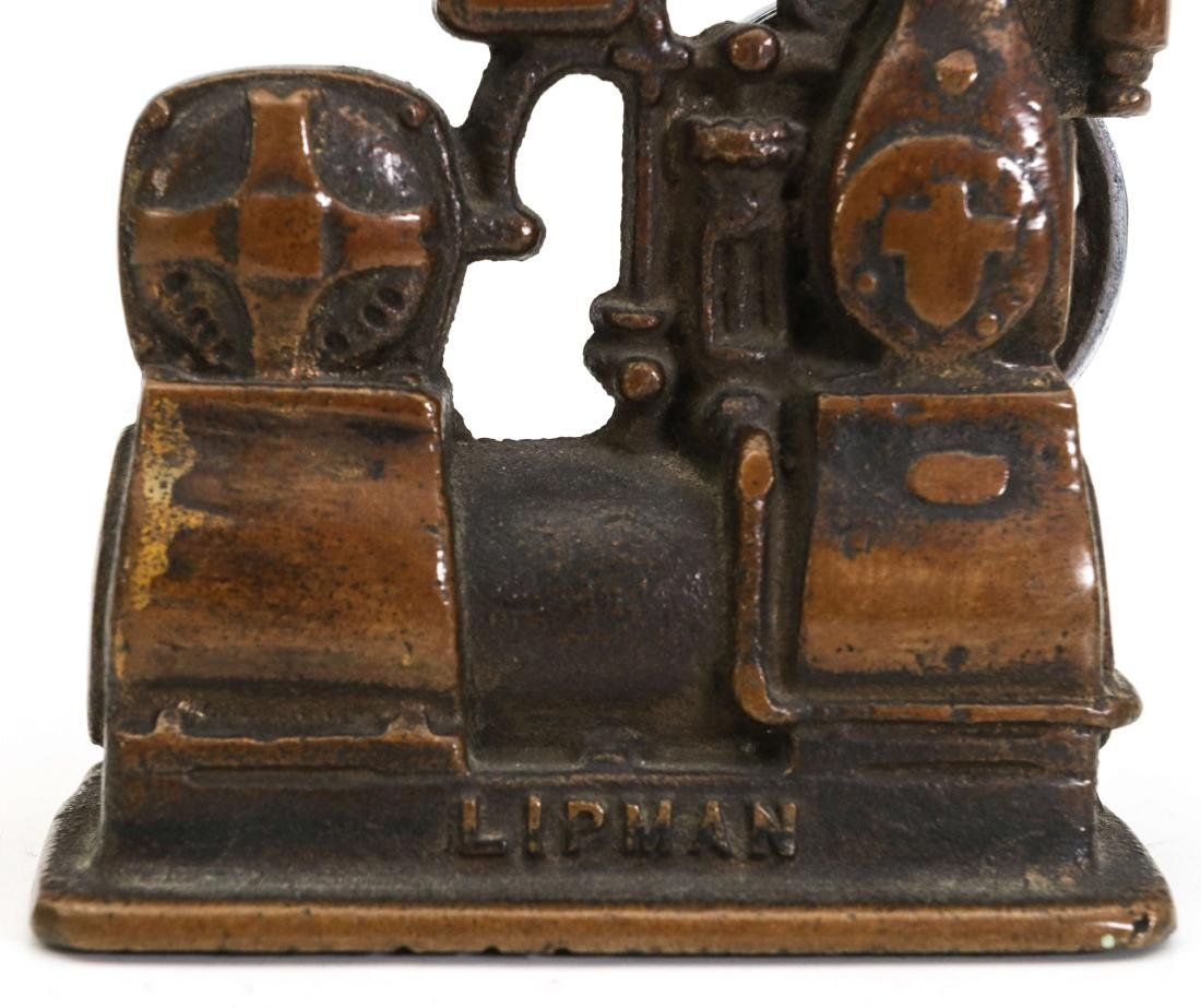 A LIPMAN FIGURAL ENGINE ADVERTISING PAPERWEIGHT - 8